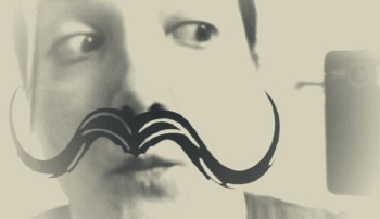 Tried to resist comical mustache mirror. Failed.